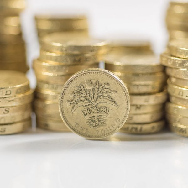 Stack of pound coins focusing on Scottish coin